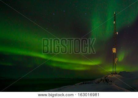 Communication Tower And Northern Lights With A Fjord In The Background, Nuuk, Greenland