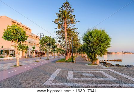 A picturesque promenade with trees in the soft morning light in Kos town, Kos island, Dodecanese, Greece.