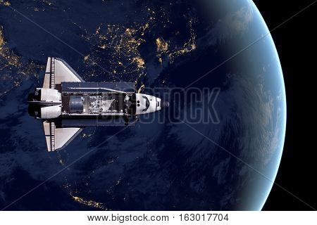 Space Shuttle and aerial night view of the World. Elements of this image furnished by NASA.