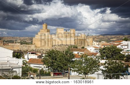 a view of Guadix and La Alcazaba on a cloudy day, Granada, Spain