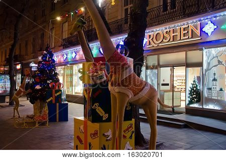 LVIV UKRAINE - DECEMBER 22: Christmas shop window Roshen in the center of Lviv on December 22 2016 in Lvov Ukraine