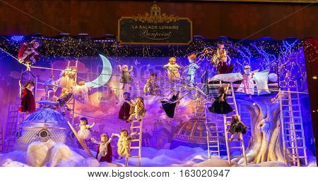 Paris France-December 24 2016 : The Christmas showcase in Printemps shopping center on boulevard Haussmann in Paris France.