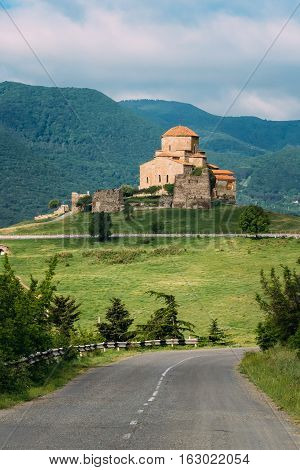 Mtskheta, Georgia. Open Road Going To Jvari, Georgian Orthodox Monastery, World Heritage By UNESCO. Beautiful Mountain Landscape And Blue Cloudy Sky Background.