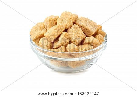Bowl of brown cane sugar cubes isolated on white background