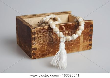 White mala rosary in the vintage wooden box. Mantra. One hundred and eight beads.