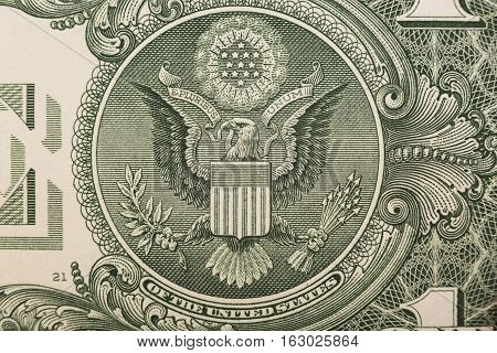 A one dollar bill close up, showing the eagle on the great seal of the United States.