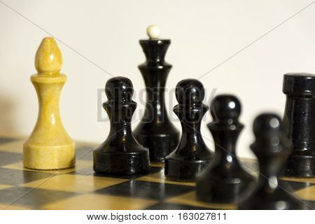 wooden chess pieces black and white pawn officer knight Queen and Bishop on the chess Board Board game