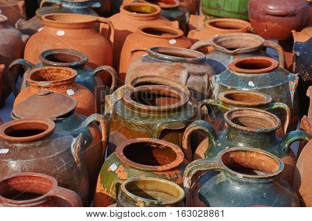 A Lot of Earthenware Crockery on the Pottery Market poster