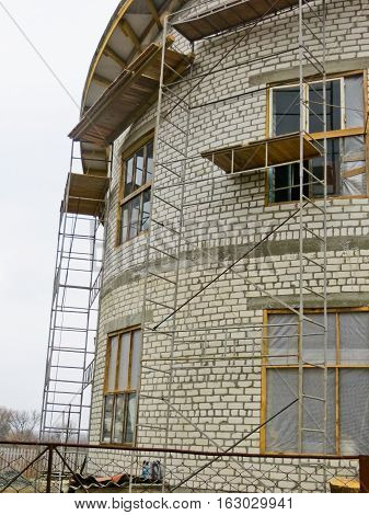 Construction of the house with white bricks