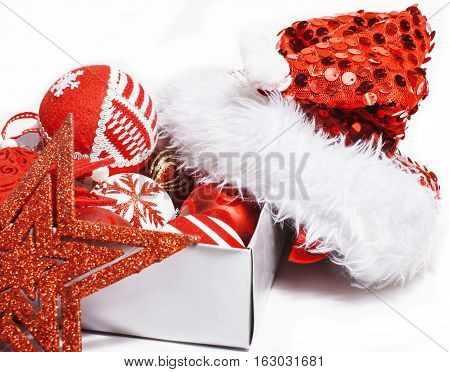 christmas decoration isolated , white background for post card greetings, toy design on tree macro, gifts under santas red hat close up macro