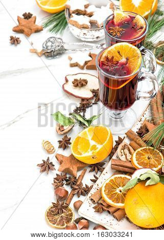 Mulled wine on white background. Hot red punch with fruit and spices. Christmas table decoration