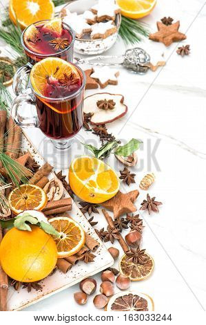 Mulled wine on white background. Hot red punch with fruit and spices. Christmas food and drinks