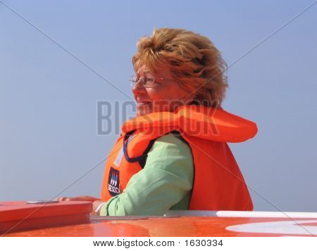 Woman In Orange Lifejacket.