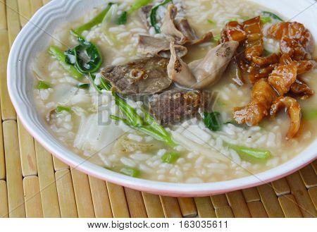 boiled rice porridge with pork entrails on bowl