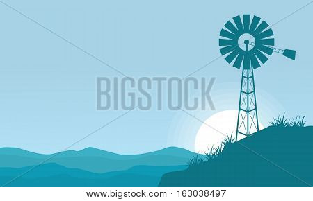 Silhouette of windmill on the hill scenery background vector
