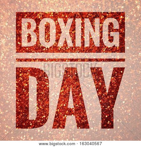 Boxing day words on shiny gold glitter background