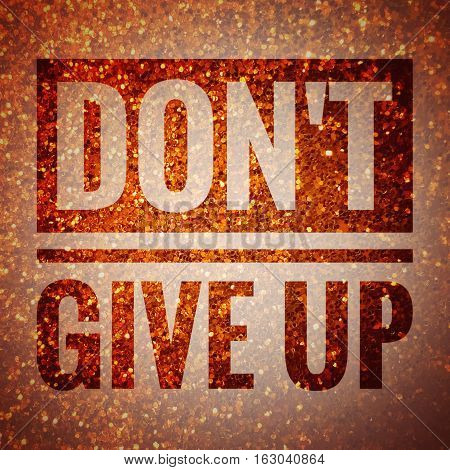 Don't give up, motivation quote on shiny gold glitter background