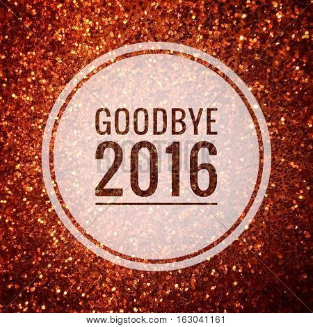 Goodbye 2016 words on shiny gold glitter background