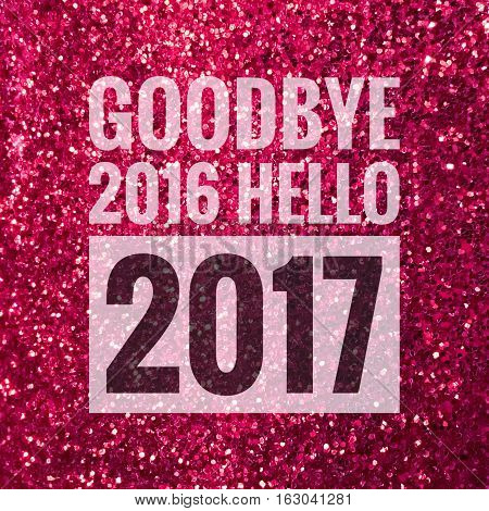 Goodbye 2016 hello 2017 words on shiny pink glitter background