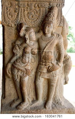 Graceful divine couple carved on stone pillar at Virupaksha Temple in Pattadakal Bagalkot District Karnataka India Asia