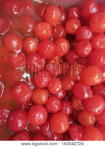 Close-up to red fruit downy cherry background
