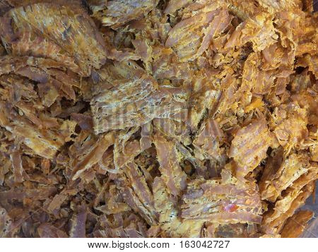 Picture close-up to crushed dried squid background
