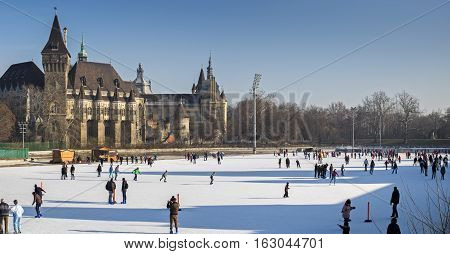 Panoramic View Of People On Ice Skating Rink Near The Vajdahunyad Castle. Budapest, Hungary.