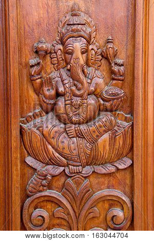 Teakwood door panel with bas relief etching of Ganesha