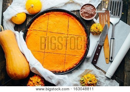 Pumpkin Pie With Autumn Decorations On Vintage Wooden Table.  Pu