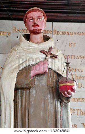 Honfleur France - august 18 2016 : statue of a monk in the Sainte Catherine church
