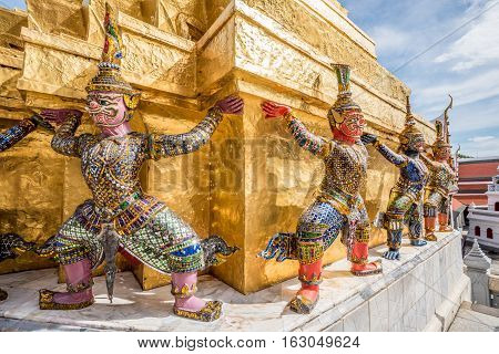 A statue of Giant Buddha on guard at the Temple of the Emerald Buddha in Grand Palace BangkokThailand.