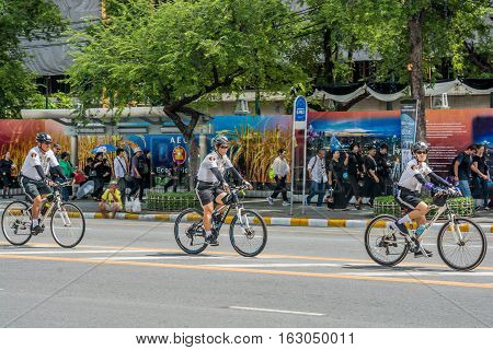 Bangkok Thailand - November 01 2016 : The tourist police bicycle at street near royal grand palace and Temple of the Emerald Buddha in funeral of His Majesty King Bhumibol in Bangkok.