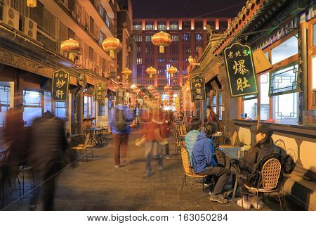 BEIJING CHINA - OCTOBER 24, 2016: Unidentified people visit Wangfujing shopping district.