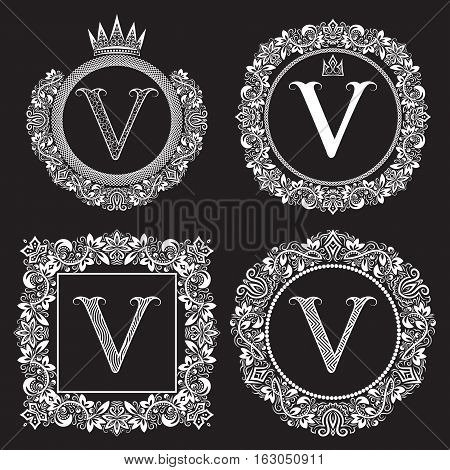 Vintage monograms set of V letter. Heraldic coats of arms in wreaths round and square frames. White symbols on black.