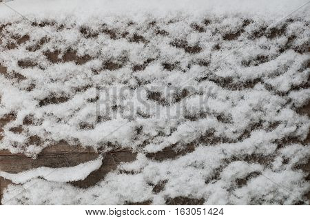 Old wooden board with snow flakes wooden background