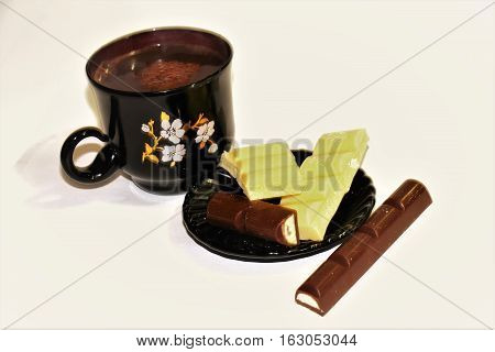 Coffee with chocolate. Coffee and chocolate are always popular with everyone. Chocolate white and black - a favorite treat for the sweet tooth.