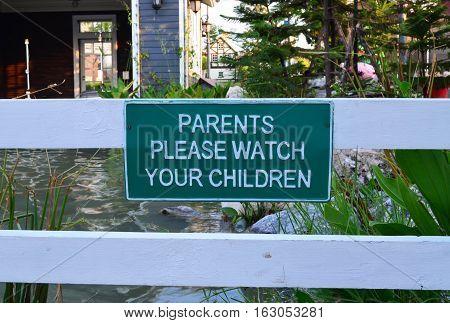 Green metal warning sign - beware of children