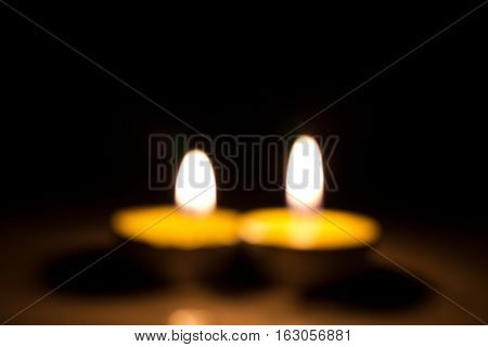 Small Round Candle Burning In The Dark Tablet