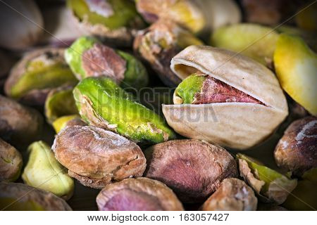 Group of roasted and salted pistachios - Macro photography