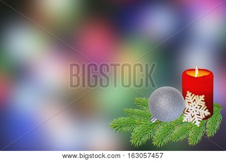 Cristmas toy and burning candle  on abstract colour background