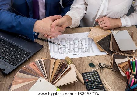 Architect concept - two architects working with blueprints in the office.