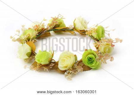 Green and white of fake flower crown or forest coronal isolated on white background.