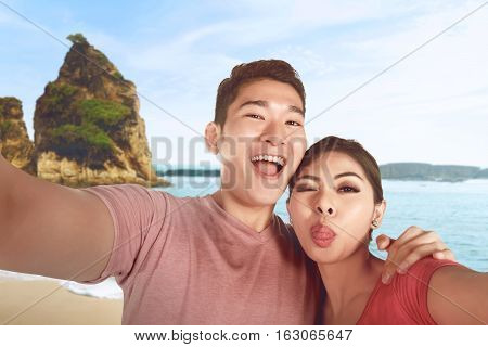 Happy Asian Couple Is Taking Selfie Photo On Vacation