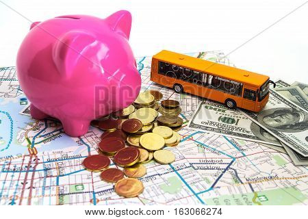 Travel Budget - Vacation Money Savings In A Pink Piggy Blank On World Map.