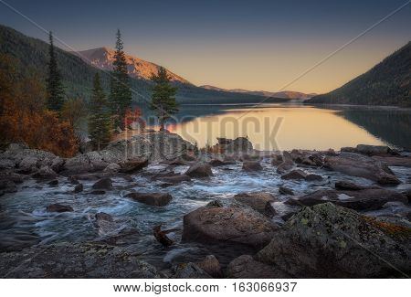 Wide And Calm Mountain River Turning To Fast Stream Sunset View, Altai Mountains Highland Nature Autumn Landscape Photo. Beautiful Russian Wilderness Scenery Image.