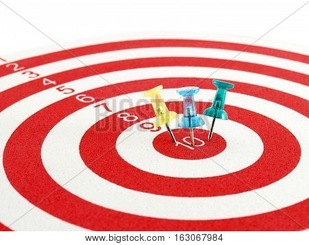 colorful pushpin on target center of dartboard, team success concept