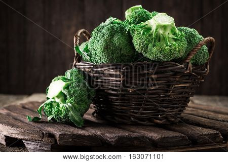 Fresh Green Broccoli In Wood Bowl Over Rustic Wooden Background