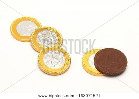 Euro chocolate wrapped in metal foil on a white background