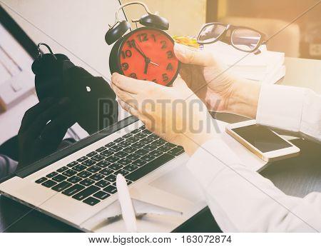 Freelance graphic designer working on deadline job until early morning.