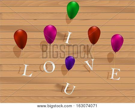 I love u sign hanging on colorful ballons